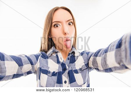 Pretty Girl Grimacing And Making Comic Selfie With Tongue