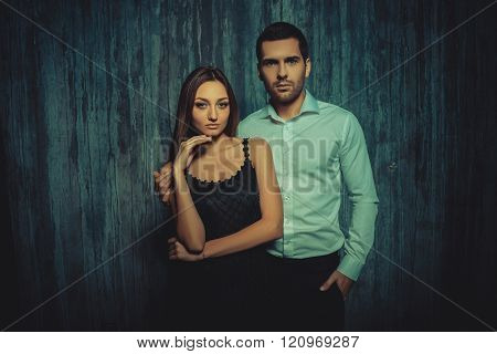 Beautiful Sexy Couple Standing Against The Dark Wall