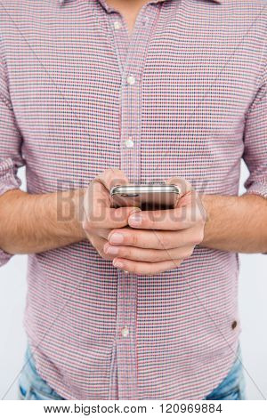 Close Up Photo Of Man Typing Message On His Phone