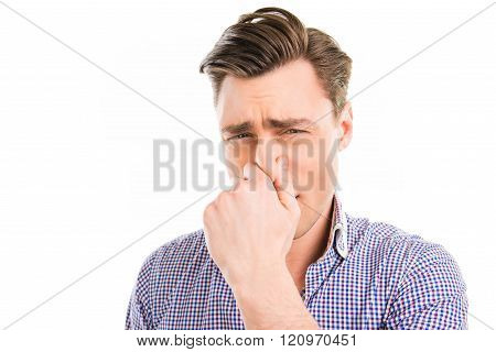Portrait Of Handsome Man With Closed Nose Because Of Stink Smell