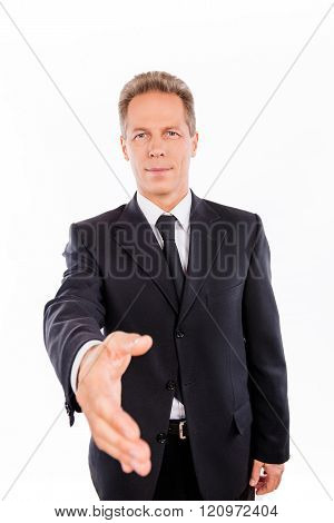 Portrait Of Aged Businessman With Outstreched Hand On The White Background