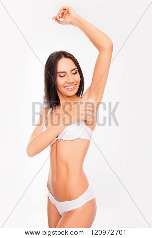 Beautiful Young Woman  In White Underwear Using Antiperspirant