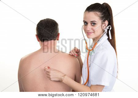 Female Doctor Listening Man's Back Through Stethoscope