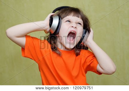 Girl Listening To Music On Headphones And Sings