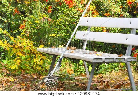 a leaf broom is modeled on a garden bench