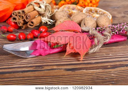 cutlery with vine leaves before autumnal decoration