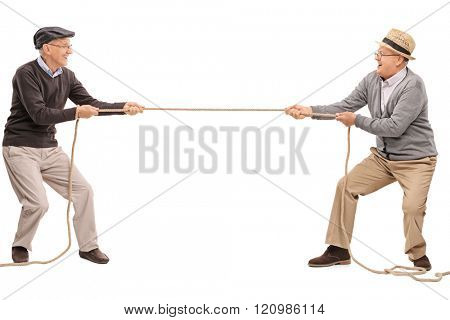 Studio shot of two cheerful seniors competing in a tug of war isolated on white background