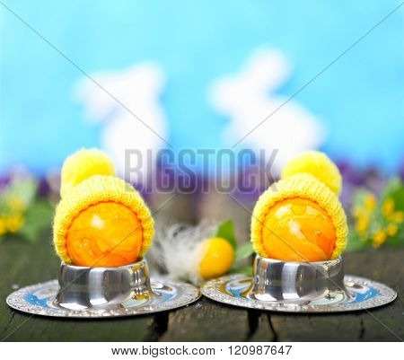two eggs with poodle hat on old wooden table