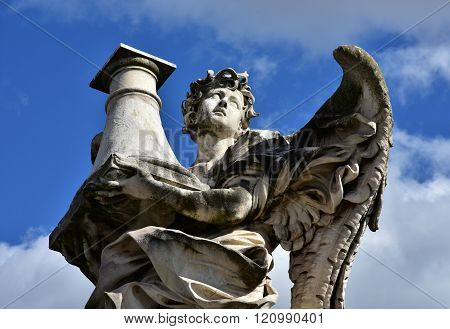 Angel With Column Looks At The Heaven, From Sant'angelo Bridge In Rome