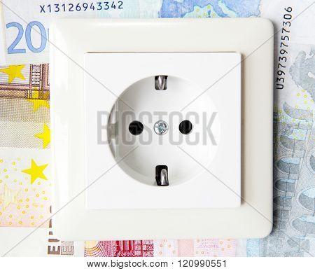 socket with money seem symbolizes high energy bill