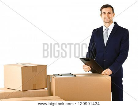 Delivery concept. Man in black suit with carton boxes isolated on white background