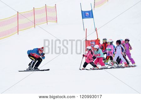 Skiing. Children's ski school. Instructor