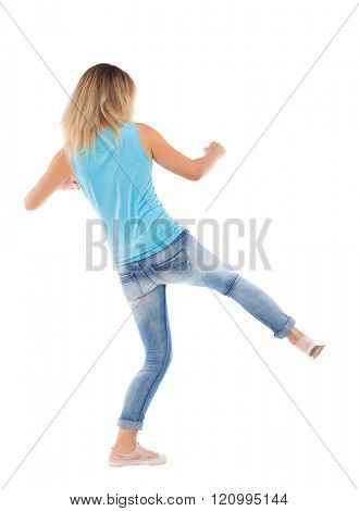 skinny woman funny fights waving his arms and legs. Isolated over white background. Blonde gets lower kick.
