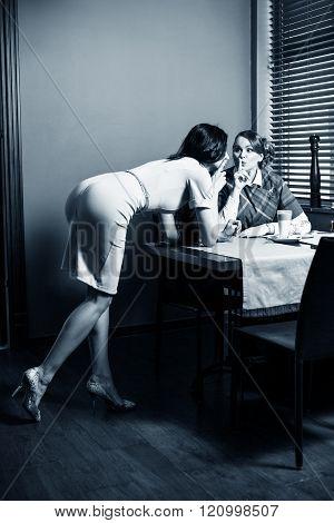 Woman whisper something to friend