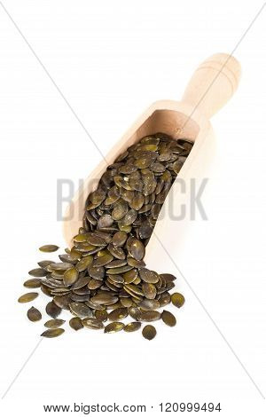 Unshelled Pumpkin Seeds In Wooden Scoop