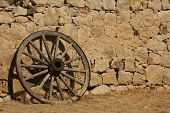 pic of stagecoach  - A Butterfield Stagecoach wheel resting against the station wall - JPG