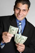 stock photo of spanish money  - Businessman Holding Money - JPG