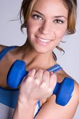 foto of weight-lifting  - Smiling Workout Woman - JPG