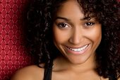 stock photo of black curly hair  - Smiling African American Woman - JPG
