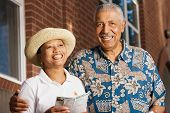 stock photo of elderly couple  - Portrait of elderly couple smiling - JPG
