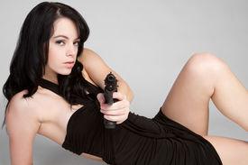 stock photo of girls guns  - Woman Holding Weapon - JPG