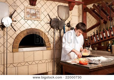 Chef Making A Pizza Base