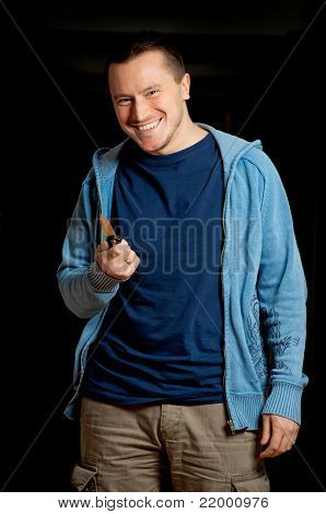 Smiling Man Holding Knife
