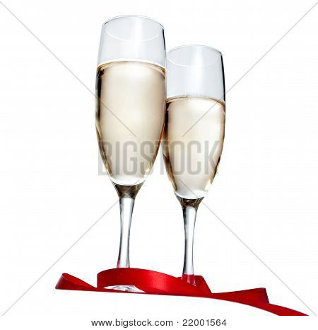Glasses with Champagne and red ribbon