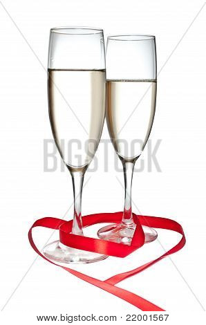 Glasses with Champagne and red ribbon isolated