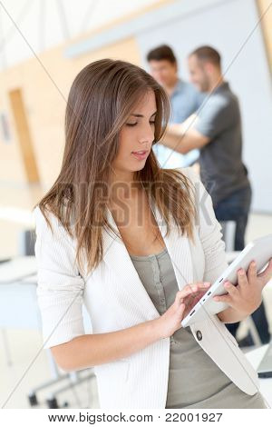 College student using electronic tablet