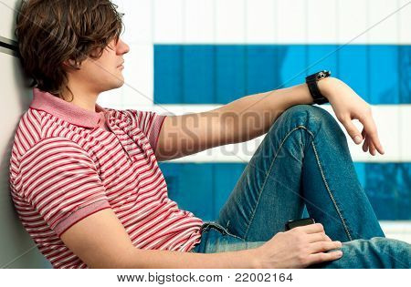 Portrait of handsome young man looking at the window