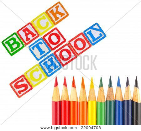 Back To School Written In Alphabet Blocks With Colored Pencils