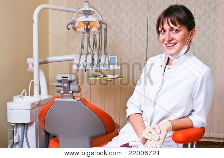 Young dentist in her office