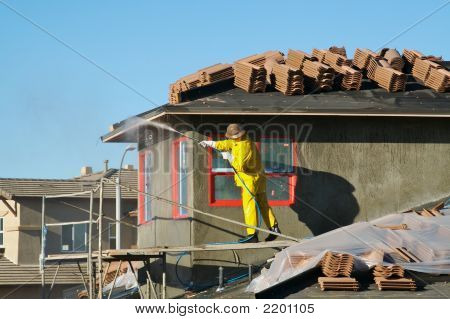 Building Construction Site Contractor On Scaffolding
