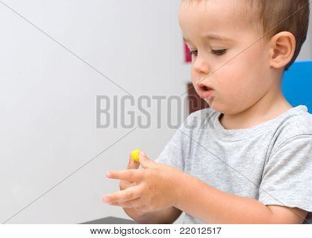 Boy And Yellow Plasticine