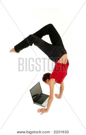 Woman Doing Handstand And Using Laptop