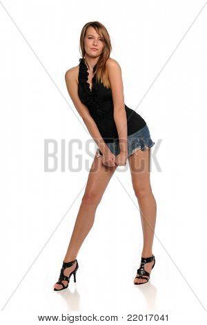 Young Brunette Woman wearing a mini skirt  isolated on a white background