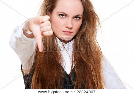 young woman giving thumbs down over white background