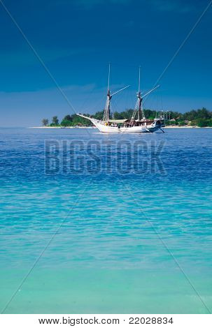 Yacht and paradise tropic island. Gili, Indonesia