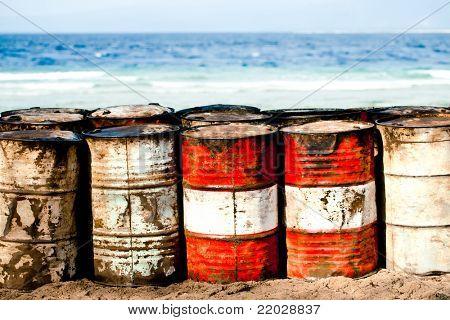 Abandoned oil barrels on the beachfront