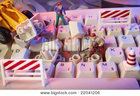 Miniature Toy Workers Repairing Computer Keyboard