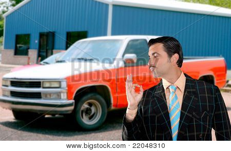 car used salesperson selling old car as brand new  typical topic salesman with hand ok gesture