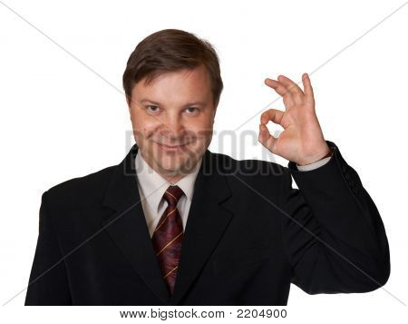 Businessman Holding Up An Ok Sign