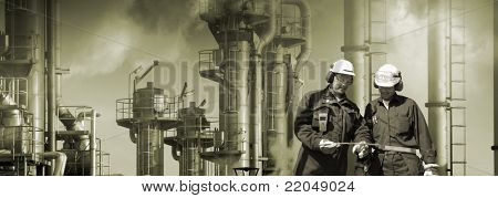 oil-workers, engineers, large oil and gas industry in background, smog and smoke, panoramic view.