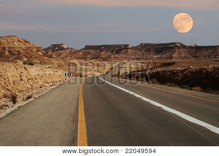 View on narrow highway running through Ramon Crater at Negev desert in Israel.