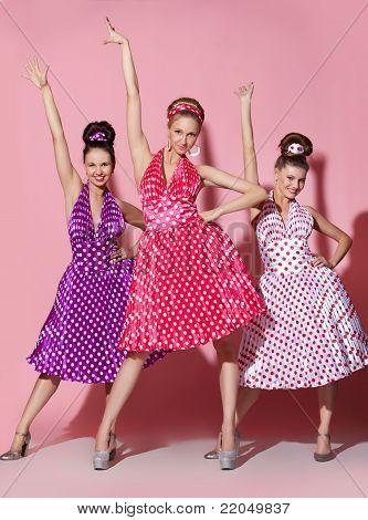 Three beautiful girls in pin up style dress