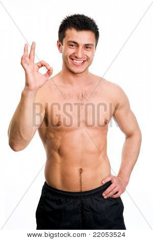 Portrait of young man showing a hand okey sign