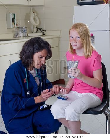 Nurse Checking Blood Sugar Level Of Diabetic