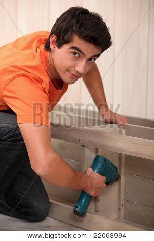 Young man making furniture
