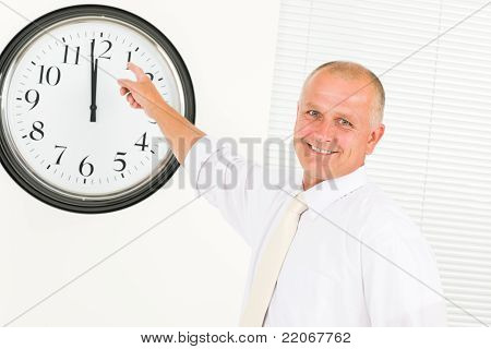 Punctual Businessman Mature Point At Clock